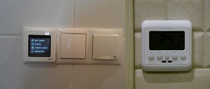 Вид терморегулятора на стене